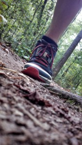 Trail Runner's Altra Lone Peak 2 shoe hitting the ground.